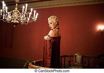 Blond woman in evening dress.