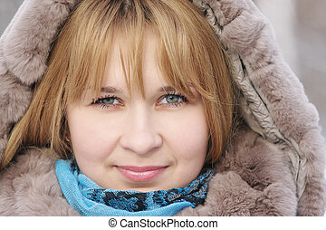 Blond woman in frosty day