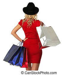 Blond woman in hat and red dress with shopping bags