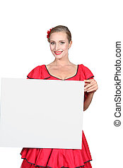 Blond woman in red dress holding message board