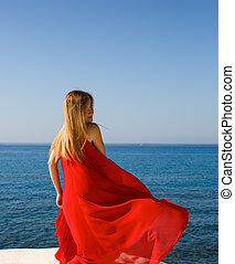 Blond woman in red