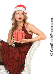 blond woman in Santa hat with Christmas present