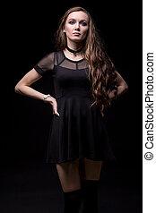 Blond woman in short black dress