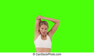 Blond woman in sportswear doing exercise
