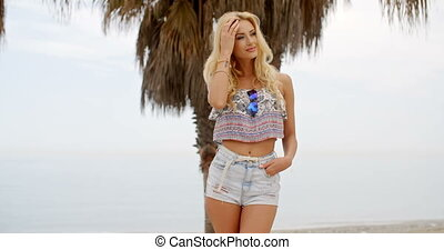 Blond Woman in Summer Clothes on Beach