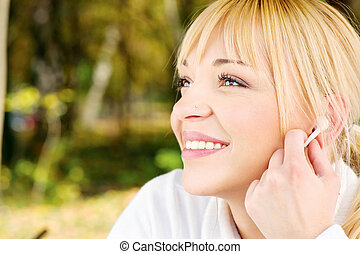 woman in the park with earphones
