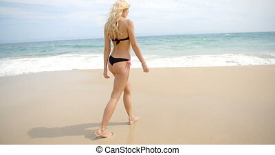 Blond Woman in Thong Bikini Walking on Beach