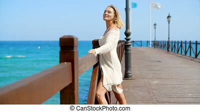 Blond Woman in White Cover Up Standing on Pier - Sexy Blond...