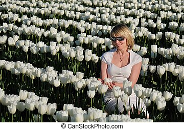 Blond woman in white flowers.