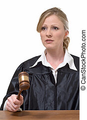 woman judge - blond woman judge holding a gavel with serious...