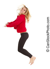 blond woman jumping