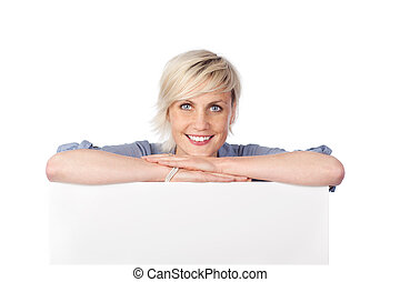 Blond Woman Leaning On White Sign