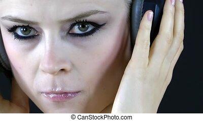 Blond Woman Listening Music with Headphone
