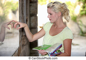 Blond woman looking at a map
