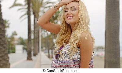 Blond Woman Looking into the Distance on Beach - Smiling...