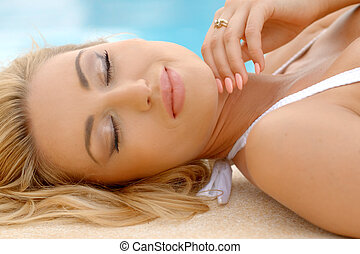 Blond Woman Lying with Eyes Closed Next to Pool - Seductive...