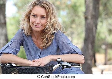 Blond woman on bike ride