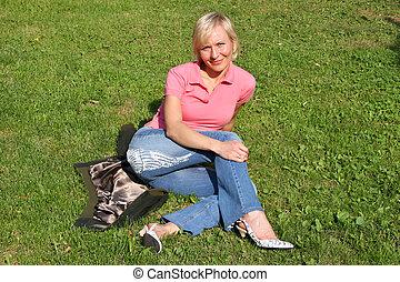 blond woman on grass