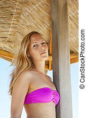 blond woman on tropical resort