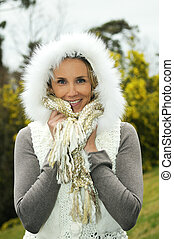 blond woman outdoor with winter closed