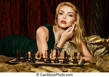 Blond woman playing chess