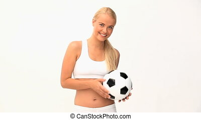Blond woman playing with a ball