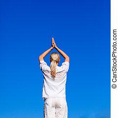 Blond woman practising yoga