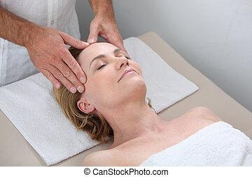 Blond woman receiving massage