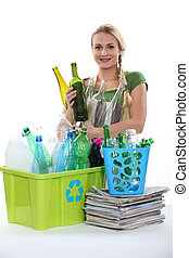 Blond woman recycling