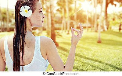 Blond woman relaxing in a rainforest