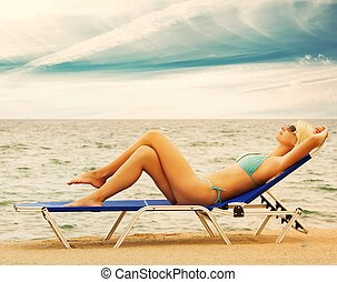 Blond woman relaxing in the sea