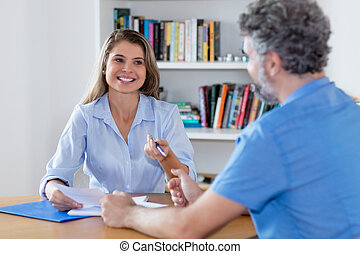 Blond woman signing contract for new job
