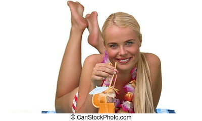 Blond woman sipping a cocktail in vacacion