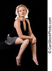 Blond woman sitting