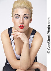 blond woman sitting on a chair in the studio