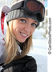 Blond woman snowboarding