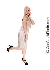 Blond woman standing in evening dress