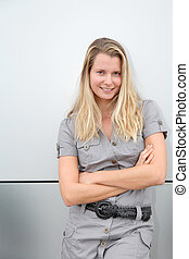 Blond woman standing on grey background