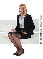 Blond woman taking survey