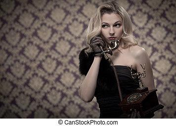 Blond woman talking on the phone. Retro portrait