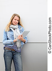 Blond woman using electronic tablet