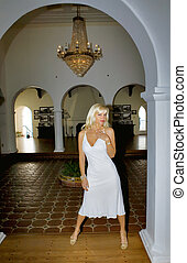 Blond Woman wearing a White Dress