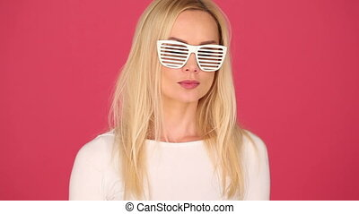 Blond Woman Wearing Funny Party Glasses