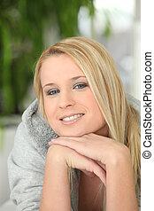 Blond woman wearing grey hooded top
