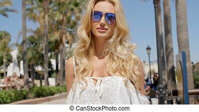 Blond Woman Wearing Sunglasses Outdoors