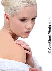 Blond woman wearing terrycloth robe