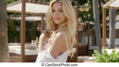 Blond Woman Wearing White Peasant Blouse at Resort - Close...