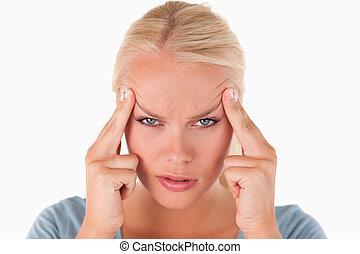 Blond woman with a headache
