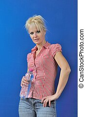 Blond woman with bottle of water