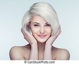 blond woman with brown eyes